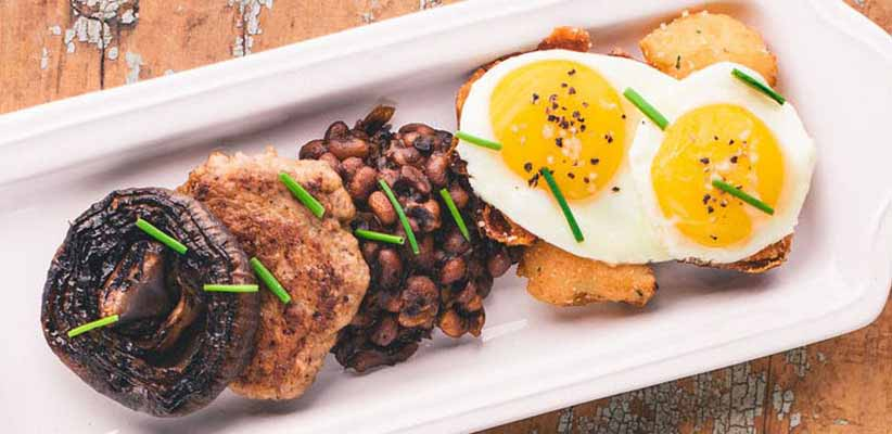 APPALACHIAN BREAKFAST sausage, cider pork black-eyed peas, roasted onion, potato cracklins, two fried eggs