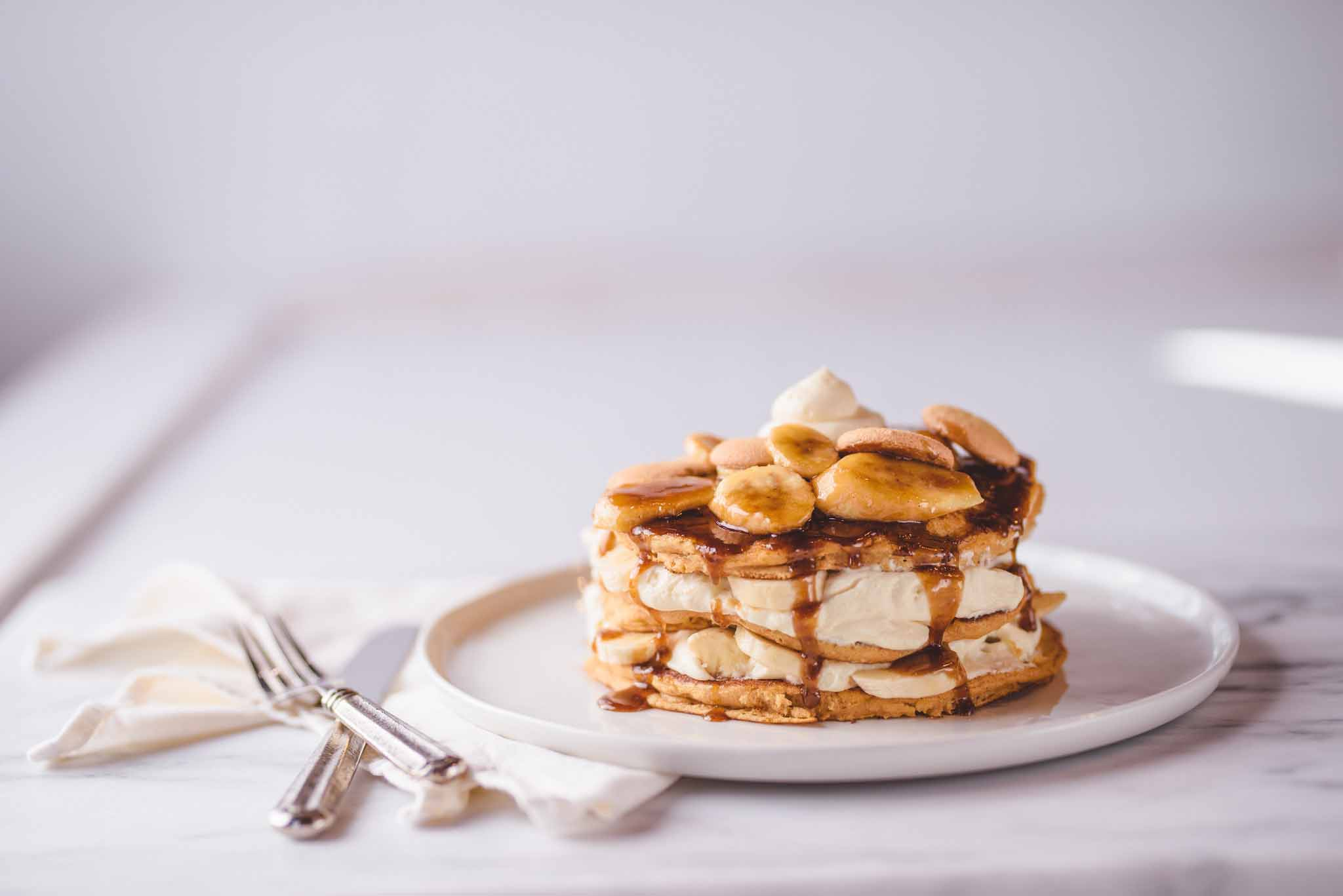BANANA PUDDING LAYERED PANCAKES foster rum sauce