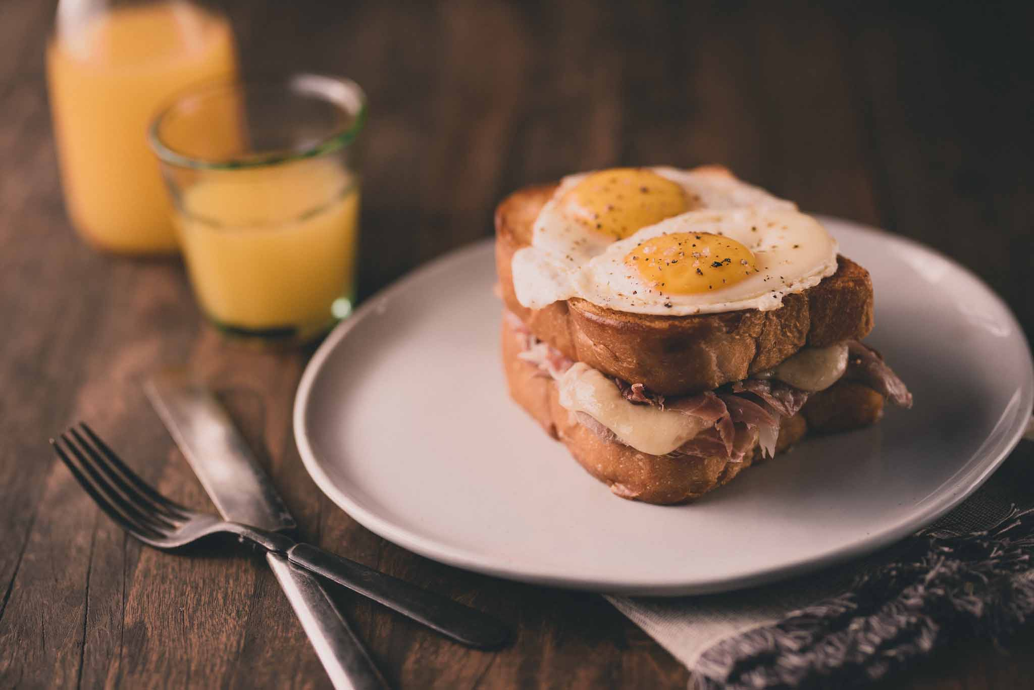 DEBUTANTE DUCK CONFIT Goodnight Brother's country ham proscuitto, Gruyere cheese, two fried eggs, on challah bread