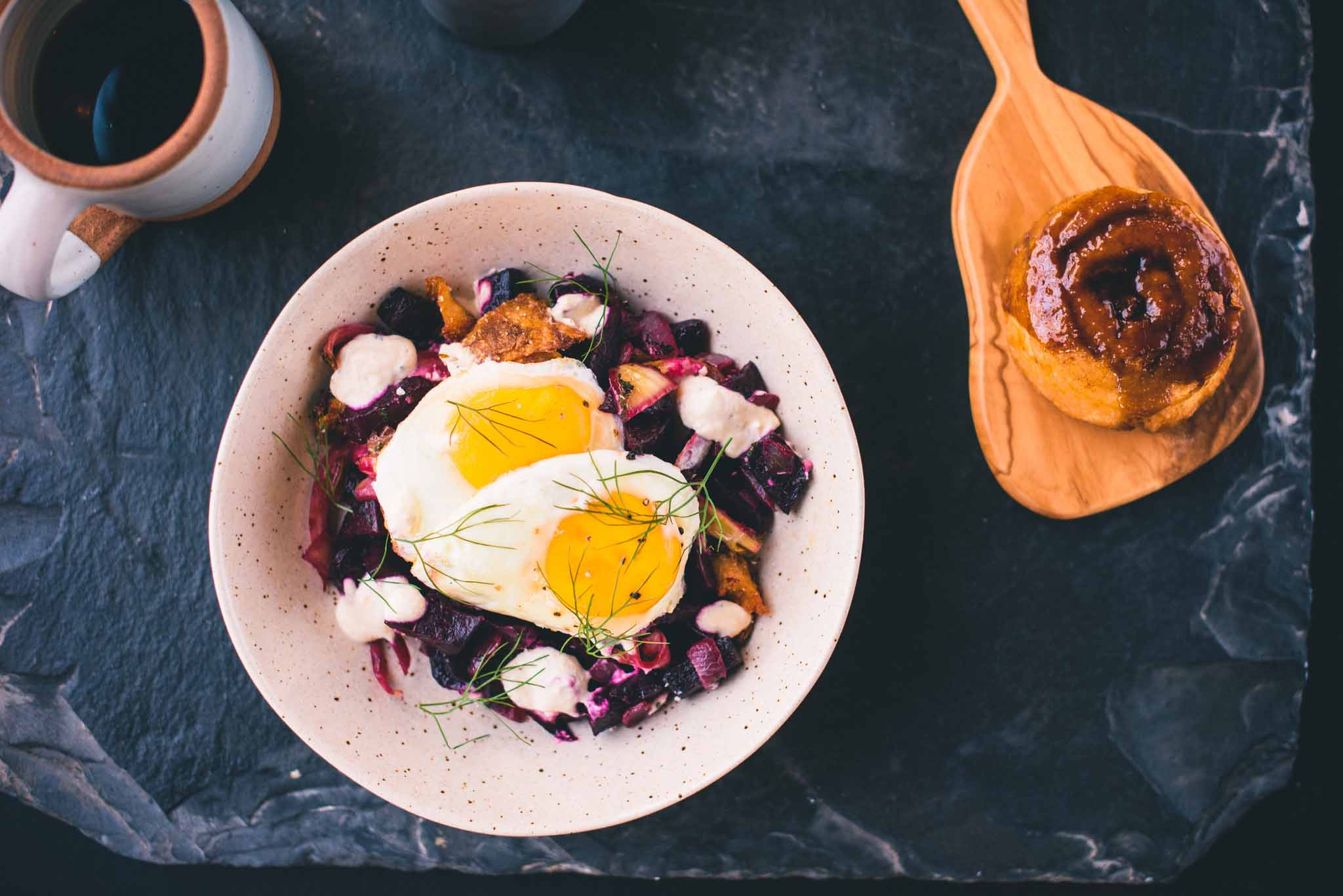 RED FLANNEL HASH salt-roasted beets, herbed potato cracklins, two fried eggs, horseradish crema, onions