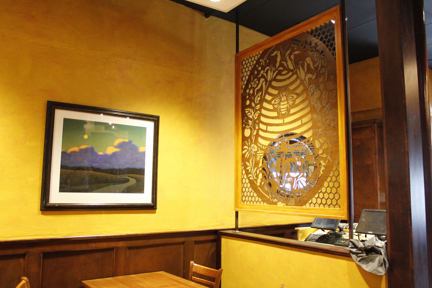 Tupelo Honey strives to use local artists to add to the communal spirit of our restaurant.