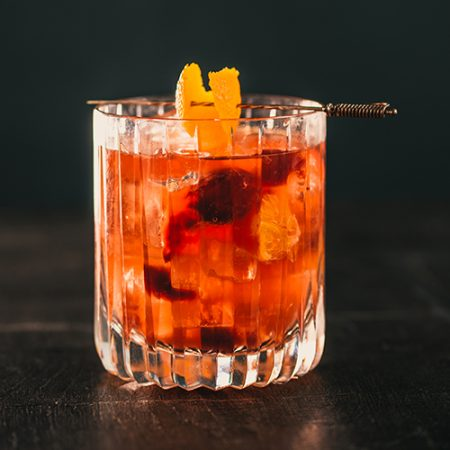 Image of Old Fashioned cocktail on black background