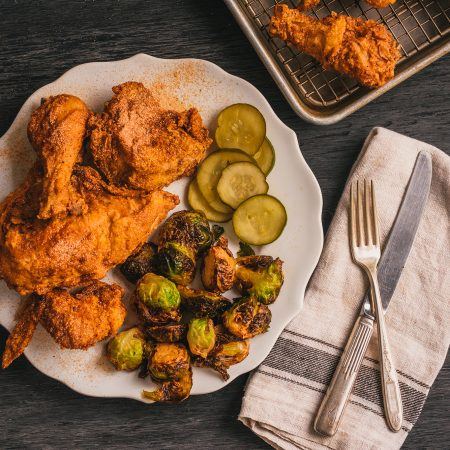 Top-down view of plate of fried chicken